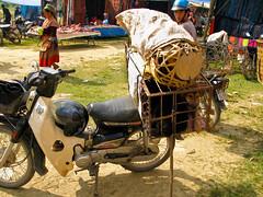Puppies on motorcycles. (Happytimeblog) Tags: vietnam hilltribe bachamarket