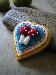 happy (lilfishstudios) Tags: red white yellow mushrooms heart recycled handmade embroidery turquoise brooch craft fiber toadstools repurposed fulled lilfishstudios feltedwoolsweater