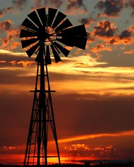 sunset silhouette - explore (Marvin Bredel) Tags: sunset sky oklahoma windmill silhouette clouds rural bravo explore cropped marvin canoneosdigitalrebelxt oldfashioned windpower 2010 topaz february20 kingfishercounty i500 marvin908 silhouetteaward bredel marvinbredel