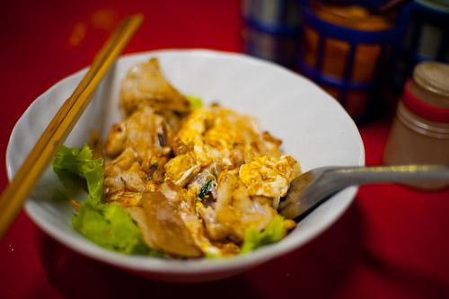 A dish of kuaytiaw khua kai at Nay Hong, a restaurant in Bangkok