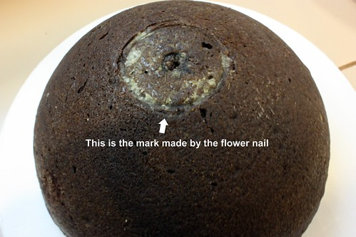 cake with flower nail mark