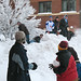 Students having a snowball fight outside of the Commons.
