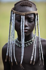 Tribal beauty (ingetje tadros) Tags: africa travel portrait people black face canon painting flickr close faces body embroidery african candid south culture shy jewelry tribal single afrika ethiopia ethnic tribo ethiopian omo thiopien etiopia ethiopie etiopa  etiopija ethnie ethiopi mursitribe  etiopien etipia  etiyopya  ethnicjewelry      memorycornerportraits    flickrmursi mursiongoogle googlemursi