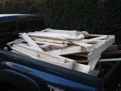 pine shipping crate wood pile in back of truck
