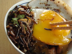 Duck Eggs Over Wild Rice: Pierced