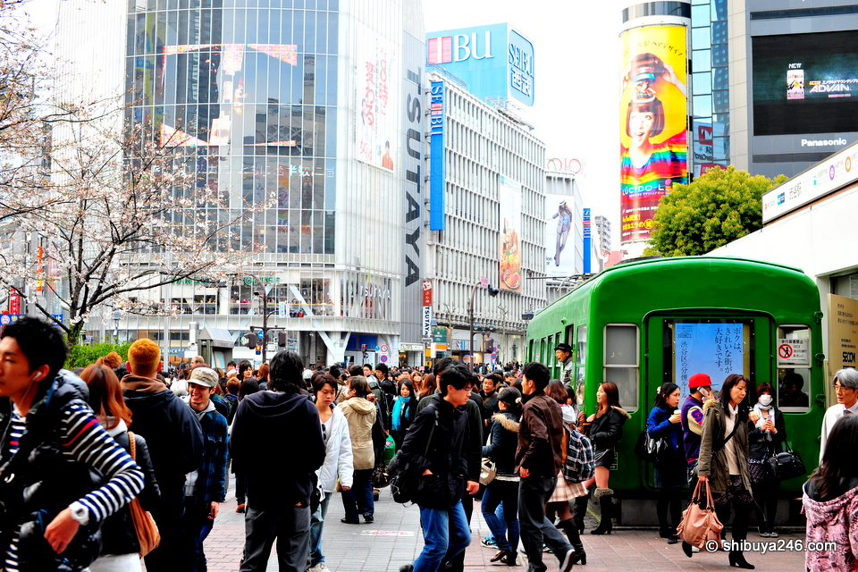 The weather is picking up and plenty of people are out in Shibuya waiting to meet friends.