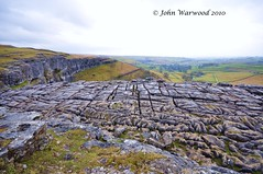 Malham Cove Limestone Pavement (JRT ) Tags: trees sky cold rain rock clouds climb nikon view hills fields walls slippery drizzle villiage limestonepavement malhamcove d90 johnwarwood flickrjrt