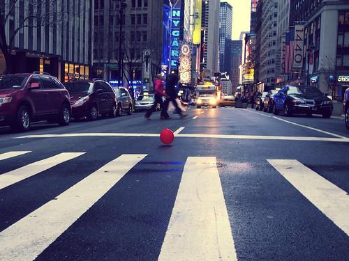 Red ball on zebra crossing