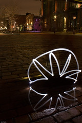 Star that looks like a spider (redgeckoTO) Tags: longexposure light toronto ontario canada lightpainting reflection night puddle star spider distillerydistrict experiment led panting lightart