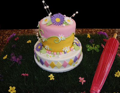Pink Purple and Yellow Daisy Birthday Cake customer display