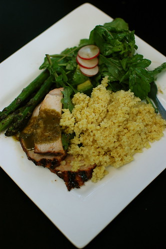 barbequed pork with green-juice sauce, millet, asparagus, and a lovely salad