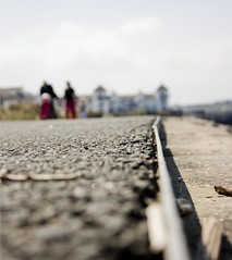 Surreal. (JemmaJusticePhotography.) Tags: england blur beach field stone canon newcastle photography eos justice holding hands couple pavement path south north east shallow depth shields jemma 450d jemmysaur