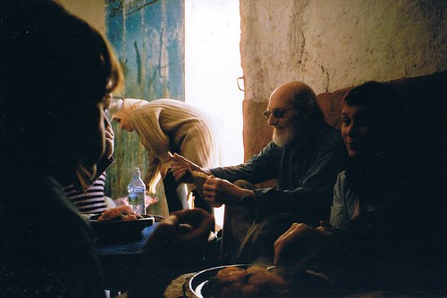 Dad sharing a meal at Dounia's family home, Morocco