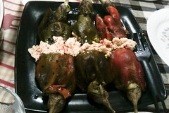 Roasted Bell Peppers stuffed with roasted eggplant and sauteed mushrooms topped with spicy crumbled feta cheese
