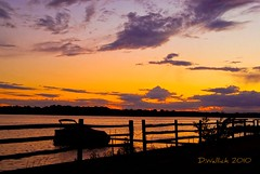 Lakeside Sunset (Doug Wallick) Tags: sunset lake water minnesota silhouette clouds fence boat dock plymouth medicine cloudscapes lightroom a230 flickraward platinumpeaceaward mygearandmepremium