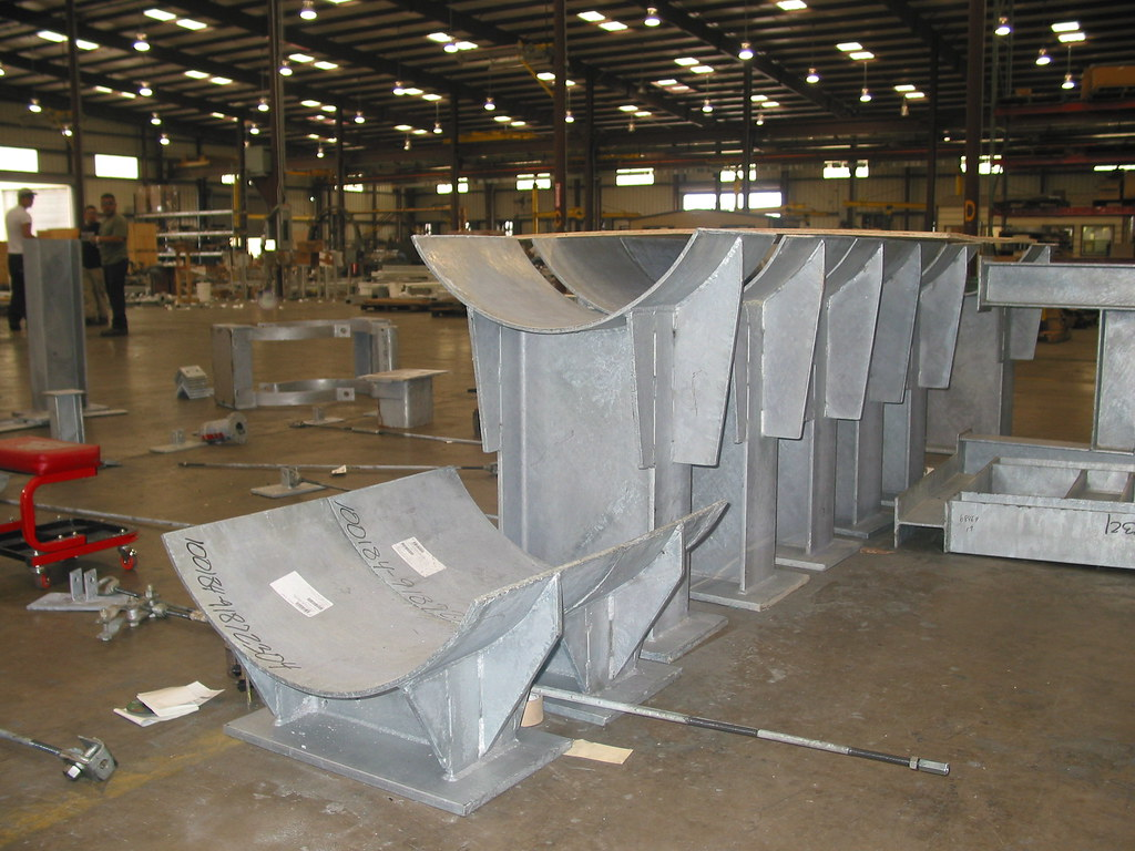 Pipe Shoes and Stand Assemblies for a Cross-Generating Station