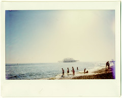 Remains of the Day (AndyWilson) Tags: west beach polaroid pier brighton fuji wide shingle instant 100 swimmers fillm instax panpola
