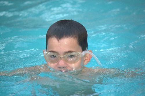 boy wet water pool swim goggles