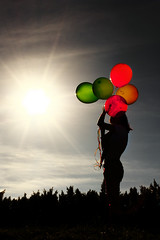 Life is always FUN! [Explored #34] (Gerardography) Tags: lighting light sunset shadow sun sol colors silhouette contrast canon atardecer happy hope is happiness sombra niña felicidad 1855mm silueta feliz globos baloons esperanza 500d t1i