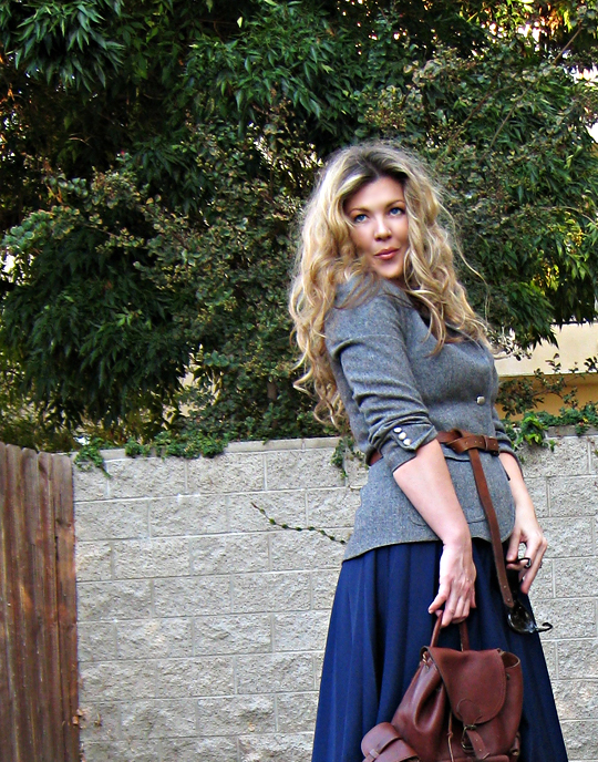 big curly hair+election day outfit+vintage blazer and skirt+leather backpack