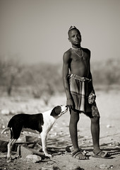 Muhimba boy and his dog - Angola (Eric Lafforgue) Tags: africa boy blackandwhite dog man tourism animal bush noiretblanc african culture tribal tribes blackpeople tradition tribe ethnic cultura chine tribo himba angola ethnology tribu tourismo herero etnia tnico etnias 7217 angolan ethnie hereros    suldeangola muhimba      16805835001263332833 southangola