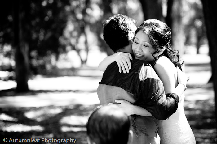 Clare & Nic's Wedding - Hugs and Kisses (by Autumnleaf Photography)