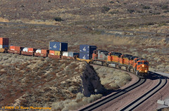 Coming Around the Bend (El Roco Photography) Tags: california railroad santafe train canon rail trains socal transportation locomotive ge bnsf cajon railroads sanbernardino freighttrain sanbernardinocalifornia emd atsf burlingtonnorthernsantafe cajonpass es44dc canonef100400mmf4556lisusm alltrains stacktrain bnsfrailroad burlingtonnorthernsantaferailroad movingtrains
