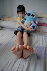 2 little monsters watching big foot (muths66) Tags: blue girl foot kid bed nikon hug stitch little wide young pillows tokina blanket softtoy d90 1116f28