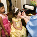Fairy Godmother does face painting on Emma!