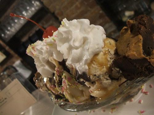 banana split with toffee crunch,toffee chocolate peanut,cake batter softserve,peanut butter swirl brownie,caramel sauce,chocolate sauce,sprinkles,whipped cream and a cherry.