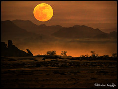 The Red Moon ! (Bashar Shglila) Tags: world africa moon mountain sahara misty photography wolf gallery desert photos top best explore most worlds dust popular libya frontpage the  libyen    akakus wolfmoon  lbia  libi libiya impressedbeauty liviya  libija thebestofday gnneniyisi   saariysqualitypictures     lbija  lby libja lbya liiba livi  mygearandmepremium wolfmoon2010 thewolfmoon