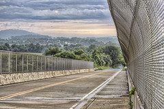 Bridge in HDR (NjCarGuy) Tags: road bridge trees rain fog clouds canon fence concrete pavement chain link puddles hdr topaz adjust t1i