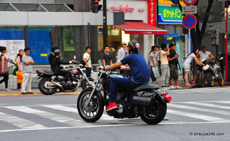 Harley through the streets. The satchel bag looks great on the back of this classic model