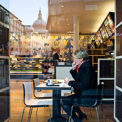 Trying to find a moment alone (Gary Kinsman) Tags: london canon5d canon28mmf18 candid street photography reflection stpauls cathedral woman sitting eating alone mobile phone garlickhill cityoflondon londonist 2010 people person