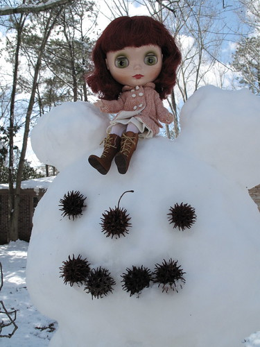Gretel loves the snowman we made int he yard!