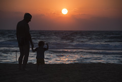 Kid watching sunset, Haifa, Israel (Mark Lukoyanichev) Tags: beach haifa israel sunset sea mediterranean people kids hellmaker