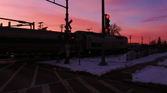 The northbound Amtrak Hiawatha crossing Chestnut Avenue at sunset. Glenview Illinois. February 2010.