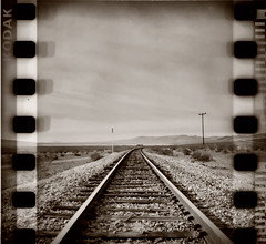 Solo track (Maureen Bond) Tags: ca wood railroad mountains film lines clouds 35mm solitude alone quiet telephone tracks brush pole dirt gravel peacefull sprockets deset blackbirdfly maureenbond