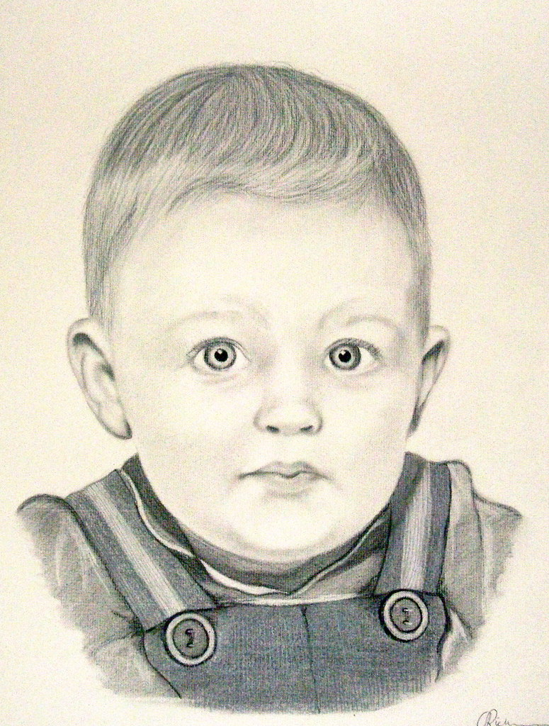Charcoal pencil portrait of a baby boy