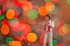 Elvis! (kevin dooley) Tags: christmas xmas old red music orange dog color green rock canon toy 50mm lights colorful time bokeh f14 14 hound elvis sing round singer microphone roll mic secretlifeoftoys plastictoy rockandroll hounddog elvispresley croon 40d allmymodelsareplastic