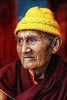 A talk from heart to heart (Apratim Saha) Tags: old portrait people india man color painting 50mm nikon buddha indian oldman nikond70s lama sikkim pilgrim sadhu nationalgeographic westbengal saha goddes siliguri 14d mywinners apratim lifeinindia lifeculture artofimages apratimsaha bestportraitsaoi