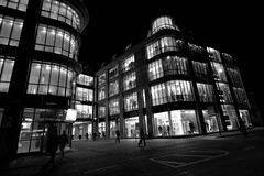 Shopping in Nürnberg - RAW slightly cropped - IMG_2004-2 (Andreas Helke) Tags: street city light people bw building shop architecture night shopping germany deutschland europa europe raw y nacht streetphotography wideangle 2006 explore utata architektur statistics potential gebäude picnik twa 1022 nürnberg mensch canonefs1022mmf3545usm promote inthecity canon1022 candreashelke haslargesize photosilove donothide upload2010