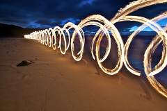 Running & Swinging with Fire (alexkess) Tags: park light seascape lightpainting beach night painting fire photography nikon lon