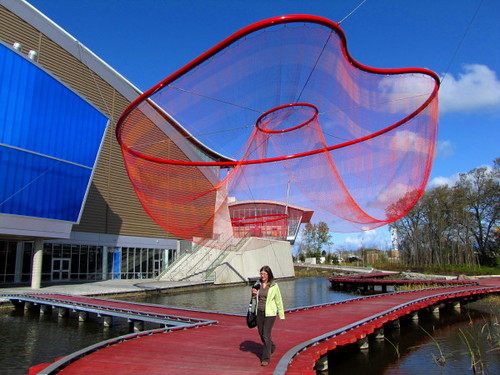 Visitor to the Richmond Oval walks under public art on the north side