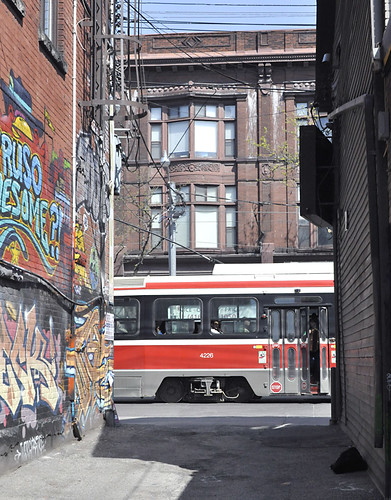 Queen St West streetcar seen from an alley by Uncle Lynx.
