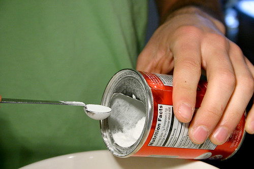 Mike carefully measures out baking soda