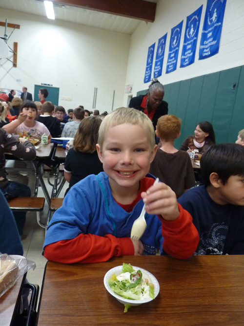 Student enjoying a salad at Waterford Elementary School