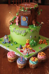 Winnie the Pooh and friends cake with matching cuppies (Andrea's SweetCakes) Tags: flowers mushrooms cupcakes vines bees snail birthdaycake ladybug winniethepooh tigger piglet eeyore treestump honeyjar
