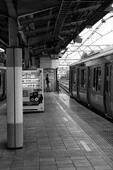 Just hanging out (Walktheworld1) Tags: blackandwhite japan train tokyo trains trainstation yamanoteline