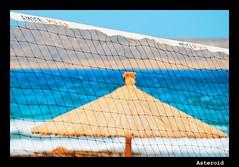 See through (Aster-oid) Tags: greece nets umbrellas beachumbrellas kassos ff112 aghioskonstantinosbeach